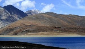 The precarious shades of blue water on the lake at Pangong